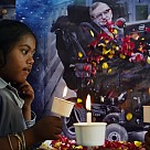 Children holding candles to honour the passing of scientist Stephen Hawking