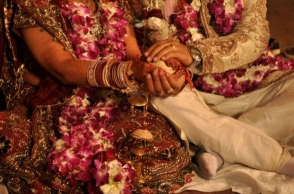 Woman pretends to be a man and marries two women